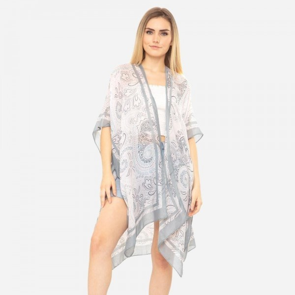 "Women's Lightweight Bordered Floral Print Kimono.  - One size fits most 0-14 - Approximately 37"" in Length - 100% Polyester"