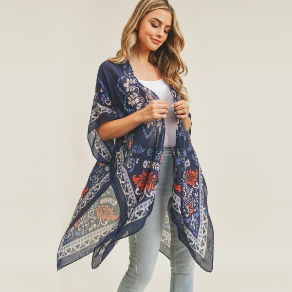 "Women's Lightweight Damask Print Kimono.  - One size fits most 0-14 - Approximately 37"" in Length - 100% Polyester"