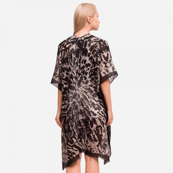 "Women's Lightweight Animal Print Kimono.  - One size fits most 0-14 - Approximately 37"" in Length - 100% Polyester"
