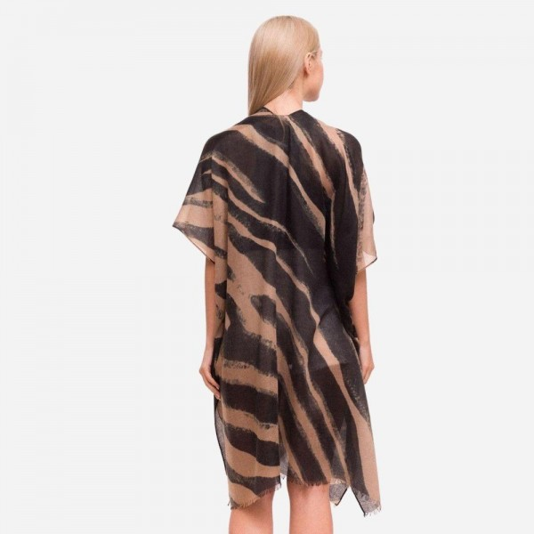 "Women's Lightweight Animal Print Kimono.  - One size fits most 0-14 - Approximately 37"" L - 100% Polyester"