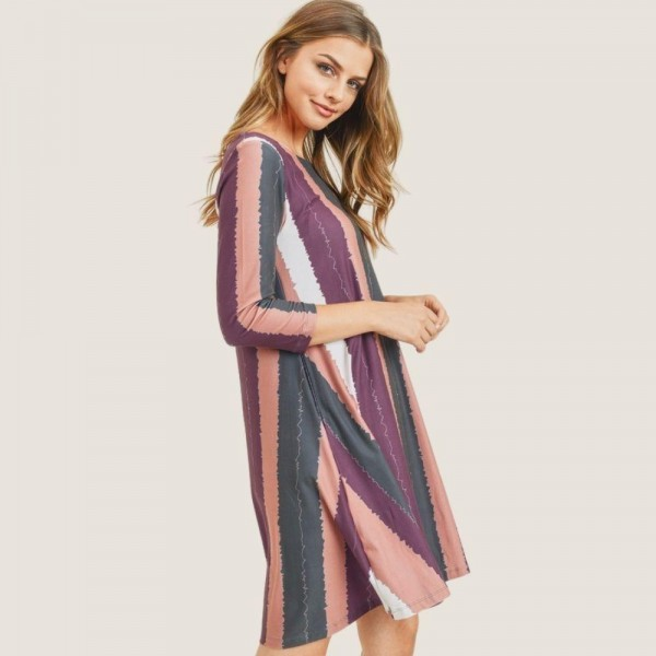 "Women's Multi-Striped Swing Dress Featuring Pockets.  • 3/4 length sleeves and round neckline • Multi-striped pattern • Two side pockets to keep your hands warm • A-line swing silhouette • Knee-length hem • Soft, stretchy and comfortable fabric • Pull over styling • Imported  - 6 Dresses Per Pack - Sizes: 2-S / 2-M / 2-L  - Approximately 34"" in Length - 90% Polyester / 10% Spandex"