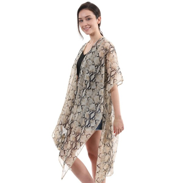 "Women's Lightweight Maxi Snakeskin Kimono.  - One size fits most 0-14 - Approximately 44"" L  - 100% Polyester"
