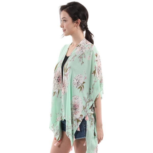 "Women's Soft Lightweight Floral Tassel Kimono.  - One size fits most 0-14 - Approximately 26"" L  - 100% Viscose"