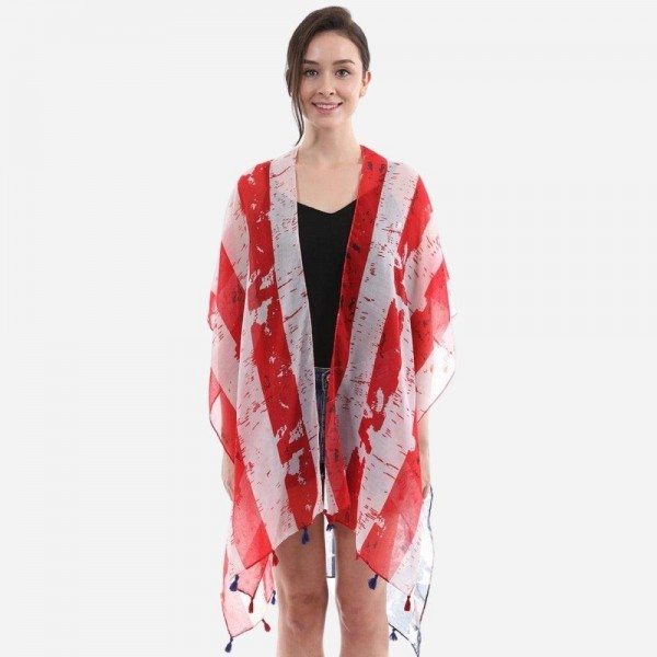 "Women's Lightweight Distressed USA Tassel Kimono.  - One size fits most 0-14 - Approximately 37"" L  - 100% Polyester"