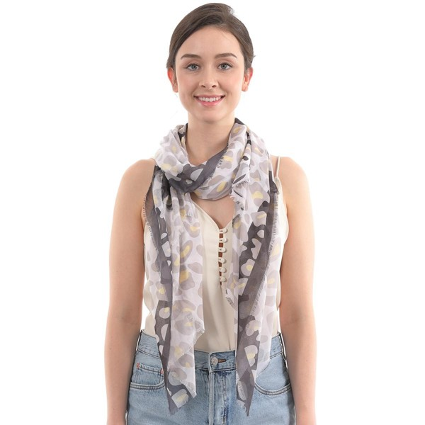 "Women's Lightweight Leopard Print Scarf.  - Approximately 35"" W x 70"" L - 100% Polyester"
