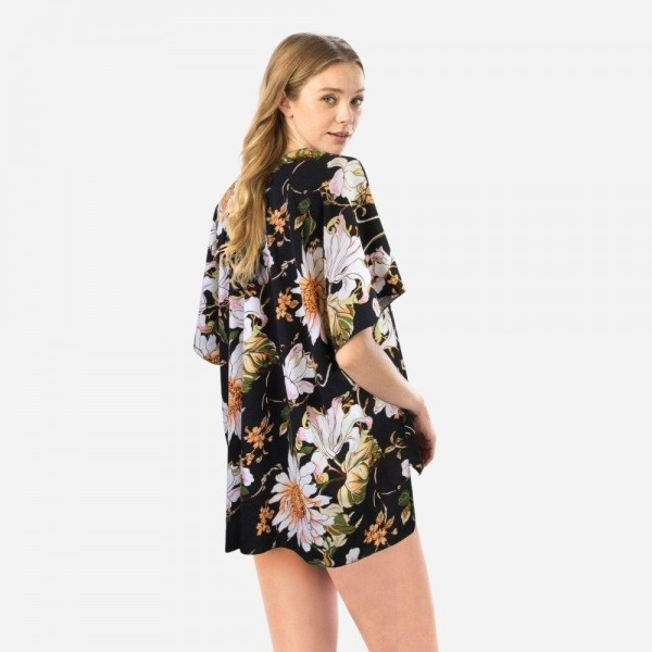"Women's Lightweight Floral Print Short Kimono.  - One size fits most 0-14 - Approximately 29"" L  - 100% Polyester"