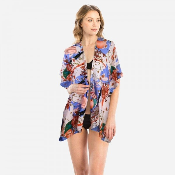 """Women's Short Floral Print Kimono.  - One size fits most 0-14 - Approximately 26"""" L  - 100% Polyester"""