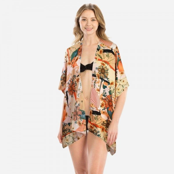 "Women's Short Floral Print Kimono.  - One size fits most 0-14 - Approximately 26"" L  - 100% Polyester"