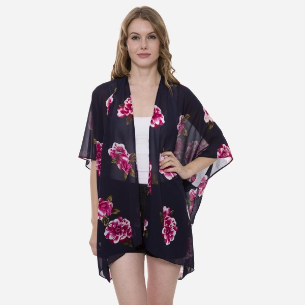"Women's Lightweight Hibiscus Floral Kimono.  - One size fits most 0-14 - Approximately 30"" L  - 100% Chiffon"