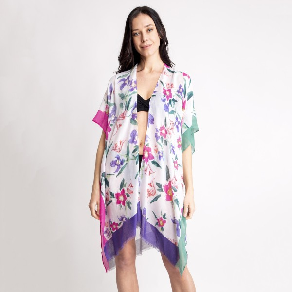 "Women's Lightweight Floral Color Block Kimono.  - One size fits most 0-14 - Approximately 37"" L  - 80% Viscose / 20% Cotton"