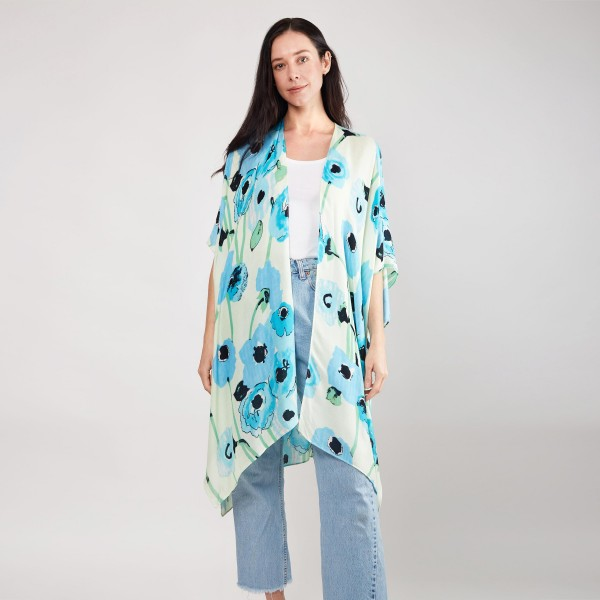 "Women's Lightweight Water Color Floral Print Kimono.  - One size fits most 0-14 - Approximately 37"" in Length - 100% Viscose"
