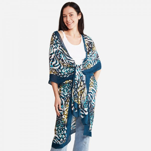 "Women's Lightweight Blue Tropical Animal Print Kimono.  - One size fits most 0-14 - Approximately 37"" in Length - 100% Viscose"