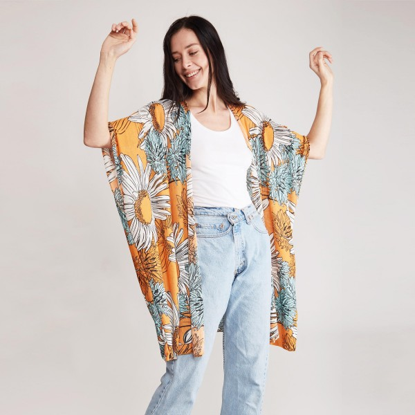 "Lightweight Floral Print Kimono.   - 100% Polyester  - One Size Fits Most  - Approximately 32"" L"