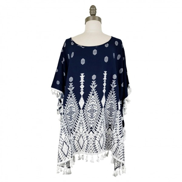 Short Sleeved Tunic Featuring an Abstract Pattern & Tassel Accents.   - Relaxed Jewel Neckline - 100% Viscose - One Size Fits Most 0-14 - Hand Wash Cold/ Do Not Bleach, Tumble Dry, or Iron