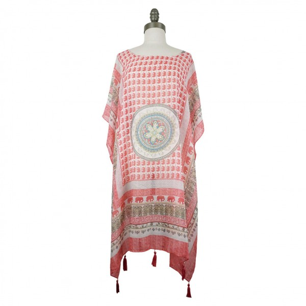 Patterned Short Sleeved Tunic Featuring Tassel Accents.   - Relaxed Jewel Neckline  - 100% Polyester - One Size Fits Most 0-14  - Hand Wash Cold/ Do Not Bleach, Tumble Dry, or Iron