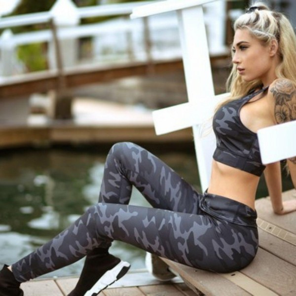 "Women's Active High Rise Dark Camouflage Workout Leggings.  • Elasticized high-rise waistband • Dark camo print • 4 way stretch moves-with-you • Moisture wick fabric • Full length design • Flattering seam details • Triangle crotch gusset eliminates camel toe • Pull on/off styling • Great for all low-high impact workouts • Imported  - 6 Pair Per Pack - Sizes: 2:S 2:M 2:L - Inseam approximately 28"" L  - 40% Polyester / 38% Nylon / 22% Spandex"