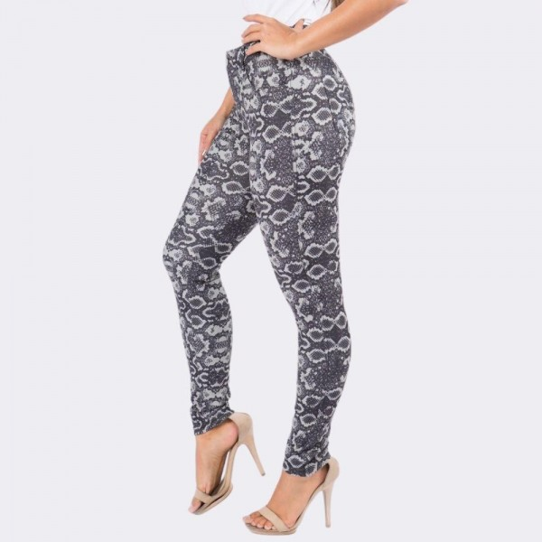 "Women's Black Snakeskin Print Cotton Blend Jeggings.  • Regular rise • Snake pattern throughout • Full length jeggings featuring a light sheen and jean-style construction • Lightweight, breathable cotton-blend material for all day comfort • Belt loops with 5 functional pockets • Super Stretchy • Shake Head Button • Pull up Style  - 6 Pair Per Pack - Sizes: 2:S 2:M 2:L - Inseam approximately 29"" L - 70% Cotton, 25% Polyester, 5% Spandex"