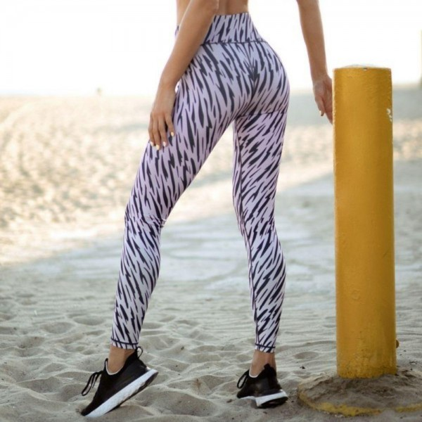 "Women's Active High Rise Tiger Print Workout Leggings. (6 Pack)  • Elasticized high rise waistband • Hidden pocket on waist for phone, keys & cash • Fits like a glove • 4-way stretch for more movement • Full length design • Squat Proof • Flat lock seams prevent chafing • Triangular Cotton Gusset Lining • Pull on/off styling • Imported  - 6 Pair Per Pack - Sizes: 2:S 2:M 2:L - Inseam approximately 28"" L  - 46% Polyester, 41% Nylon, 13% Spandex"