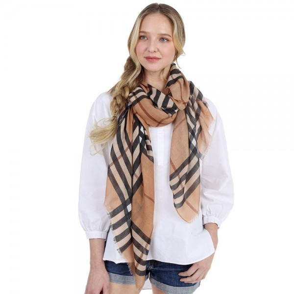 "Lightweight Plaid Scarf.   - 100% Polyester  - Approximately 60"" L x 32"" Wide"