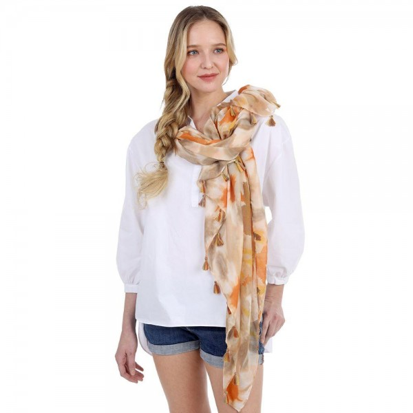 "Tie-Dye Scarf Featuring Tassel Accents.   - 100% Polyester - Approximately 60"" x 35"""