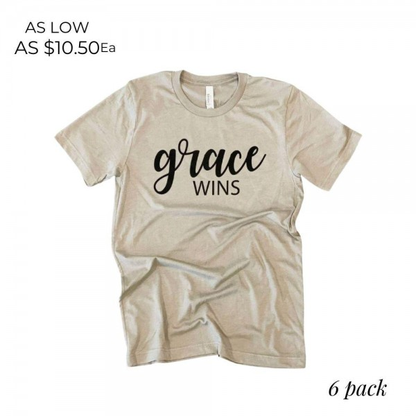 Grace Wins Graphic Tee.  - Printed on a Bella Canvas Brand Tee - Color: Stone  - 6 Shirts Per Pack - Sizes: 1:S 2:M 2:L 1:XL - 100% Cotton   * Regularly priced items.