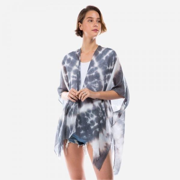 "Lightweight Tie-Dye Burst Kimono.   - One Size Fits Most 0-14 - 100% Polyester - Approximately 32"" Long"