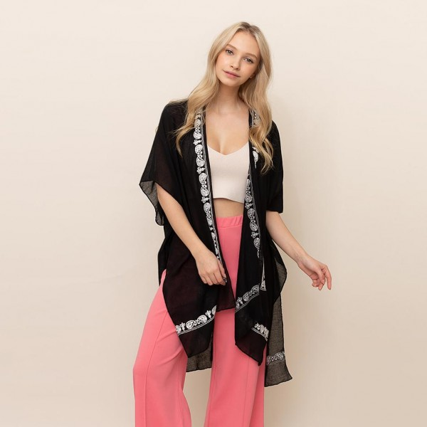 """Lightweight Kimono Featuring Embroided Paisley Accents.   - One Size Fits Most 0-14 - 65% Polyester, 35% Viscose - Approximately 35"""" L"""