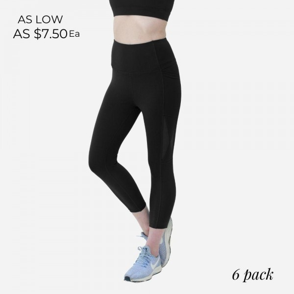 Black Athletic Capri Leggings Featuring Side Pockets and Mesh Accents. (6 Pack)   - Spandex Compression Fit  - Breathable Moisture Wicking Fabric - High Waist Design - Features Two Side Pockets  - 6 Pairs Per Pack  - Sizes: 1 S / 2 M / 2 L / 1 XL
