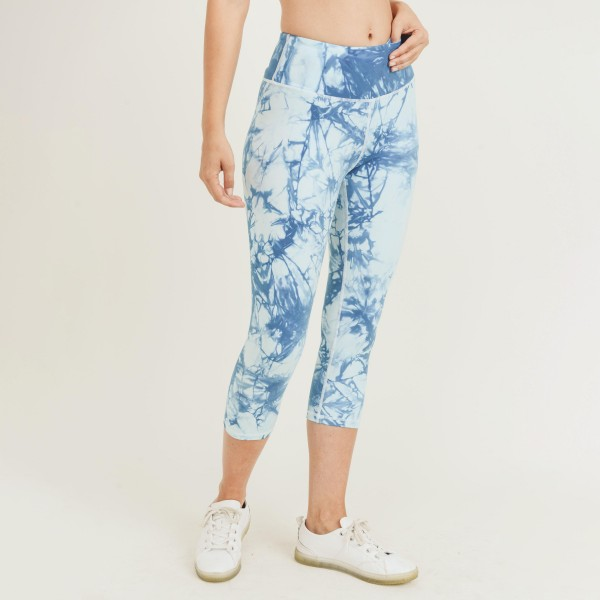 Blue Tie-dye Capri Leggings Made Out of Buttery Soft Fabric. (6 Pack)  • Elasticized pocket waistband • Unique tie-dye print design • 4-way stretch for a move-with-you feel • Super soft brushed knit fabrication • Moisture wicking fabric • Cotton Gusset Lining • Squat Proof • Buttery Soft • Great for all low-high impact workouts  - Material: 75% Nylon, 25% Spandex - Pack Breakdown: 6pcs/pack. 2S: 2M: 2L