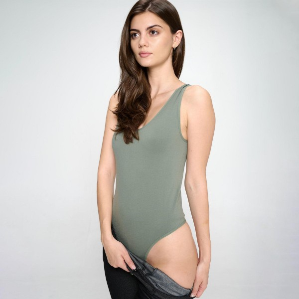 Seamless V-neck Bodysuit Featuring an Asymmetrical Neckline and a Thong Fit that Remains Invisible Under Clothing.   • V-neck Cut • Seamless Design, No Clasps • Thong Fit • Soft and Stretchy Fabric • 92% Nylon, 8% Spandex  - Pack Breakdown: 6pcs/pack. - One Size Fits Most.
