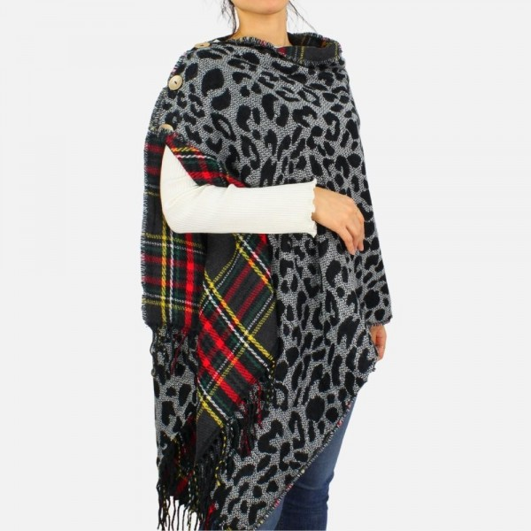 Convertible and reversible poncho with fringe tassel and button details. -Reverses from plaid to animal print -One size fits most 0-14 -100% Acrylic