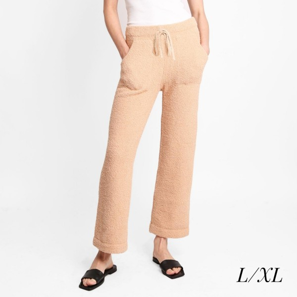"""Women's Wide Leg Drawstring Lounge Pants  • Size: L/XL (Sizes 10-14) • Approximately 42"""" in Length • 30"""" Inseam • 100% Polyester • Drawstring high-rise waistband • Two pockets for keeping your hands warm • Wide leg silhouette • Soft and comfortable fabric with stretch • Comfortable, relaxed fit • Flare hem • Style with your favorite tee for a laid-back look • Soft and stretchy • Comfortable for lounging at home"""