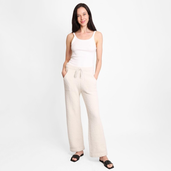 """Women's Wide Leg Drawstring Lounge Pants   • Size: S/M (Sizes 2-8) • Approximately 41"""" in Length • 29"""" Inseam  • 100% Polyester  • Drawstring high-rise waistband  • Two pockets for keeping your hands warm • Wide leg silhouette • Soft and comfortable fabric with stretch • Comfortable, relaxed fit • Flare hem • Style with your favorite tee for a laid-back look • Soft and stretchy • Comfortable for lounging at home"""