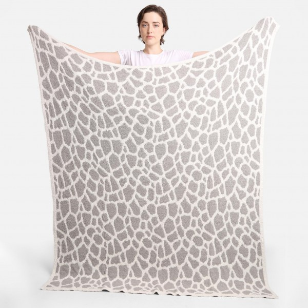 """Super Soft Jacquard Giraffe Print Comfy Luxe Knit Blanket. The Softest Throw Blanket Made of the Highest Quality Material. So Soft You Have to Feel Them for Yourself. This Luxurious Throw is a Guaranteed Best Seller this Season!   - Approximately 50"""" W x 60"""" L -100% Polyester  - Extra Plush and Cozy"""