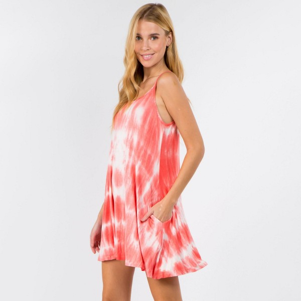 """Tie Dye Dress Featuring Lightweight Jersey Knit Fabric, a Rounded Neckline, Two Pockets, and Thin Straps with a Crisscross Back.    • Relaxed Scoop Neckline • Sleeveless • Thin, Strappy Details • Side Pockets • Swing Style Bodice • Tie Dye • Pullover Style   Model Stats: 32 x 24 x 36 Height 5'8""""   Material: 95% Rayon, 5% Spandex  Pack Breakdown: 6pcs/pack. 2S: 2M: 2L"""