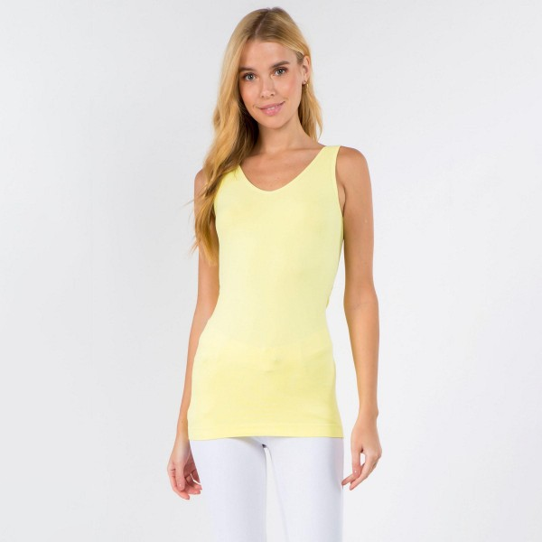 Women's Seamless Reversible V-Neck Tank Top.   - Wide shoulder straps  -  V-neckline  - Back scoop neck  - Fitted silhouette - Seamless design  - Buttery soft fabrication with stretch  - Pull on/off  - Longline hem   - One size fits most 0-14  - 92% Nylon, 8% Spandex