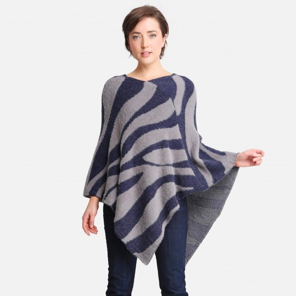 """Women's Faux Fur Zebra Print Poncho   - One size fits most 0-14  - Approximately 35"""" Long  - 100% Polyester"""