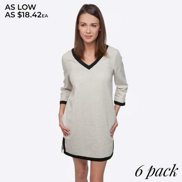 Tan tunic dress with 3/4 length sleeves. Sold in packs of six - one small, two mediums, two larges, one extra large.