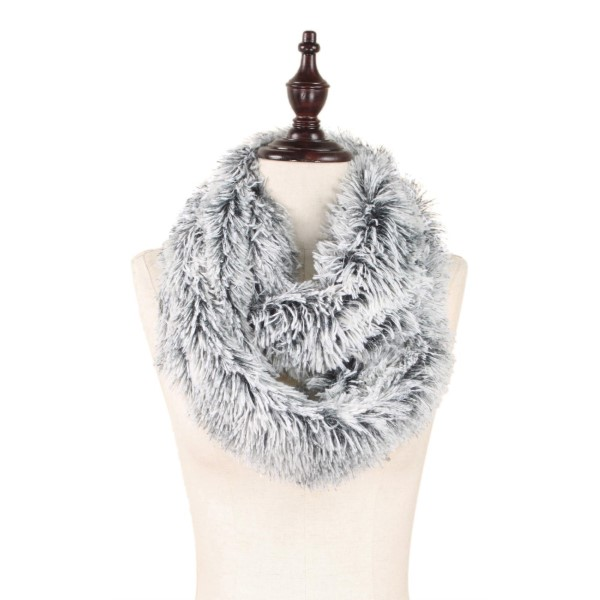 """Black and white faux fur infinity scarf. 100% polyester. Measures 8"""" x 30"""" in size."""