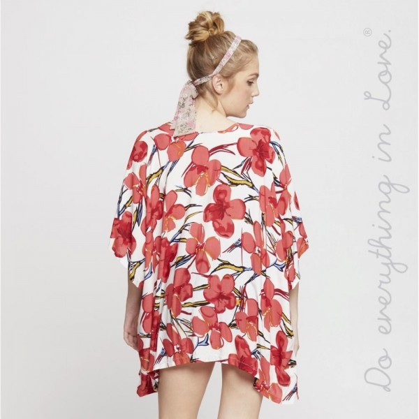 "Do everything in Love brand lightweight tropical floral short kimono.   - One size fits most 0-14 - Approximately 28"" L - 100% Viscose"