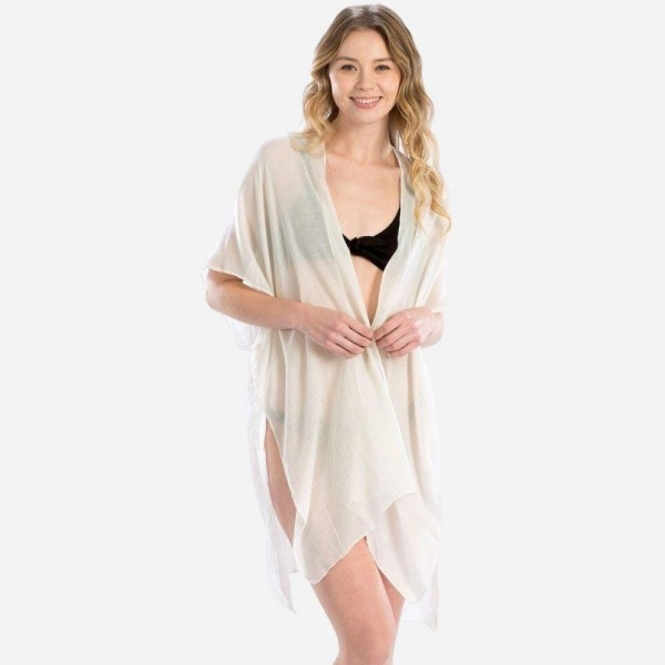 "Women's Lightweight Sheer Kimono Featuring ""Bride"" Back Detail.  - One size fits most 0-14 - Approximately 35"" in Length - 100% Viscose"
