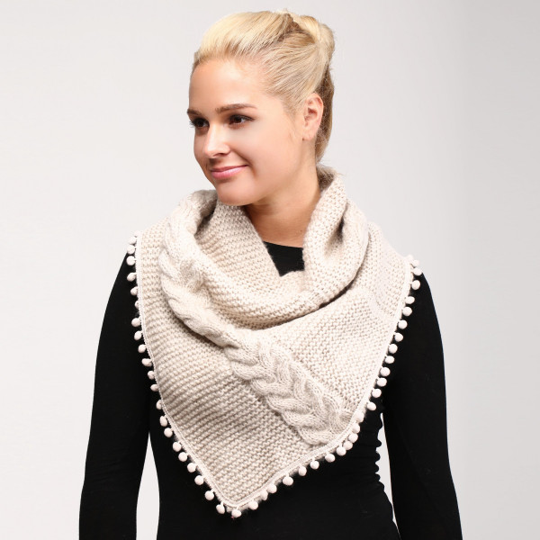 Solid Cable Knit Scarf Featuring Pom Pom Trim.  - 100% Acrylic