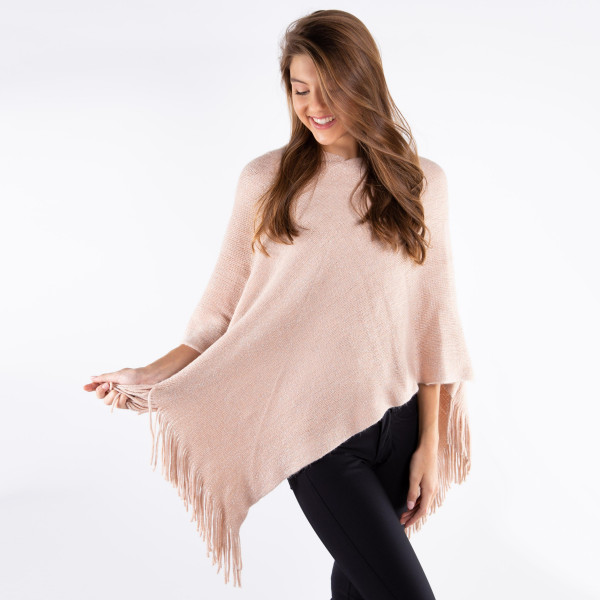 Lurex mix knit poncho with fringes.  - One size fits most 0-14 - 100% Acrylic