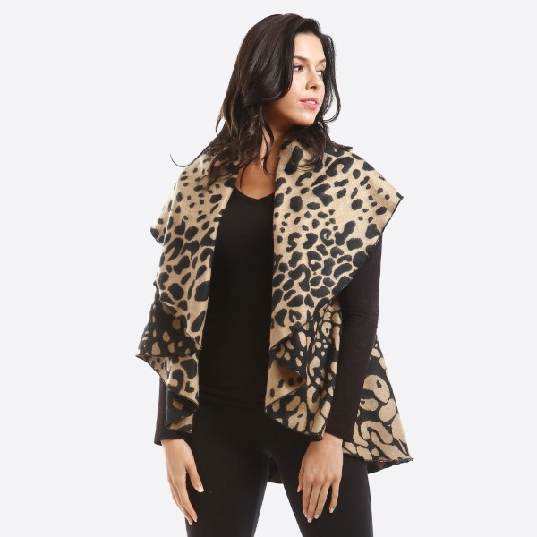 """Leopard Print Round Vest.  - One size fits most 0-14 - Approximately 35"""" L; 60"""" in diameter - 100% Polyester"""