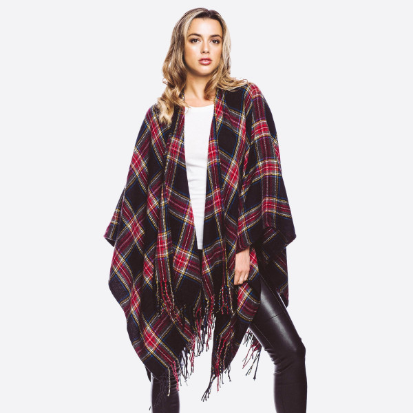 Plaid print ruana with fringes.  - One size fits most 0-14 - 100% Acrylic