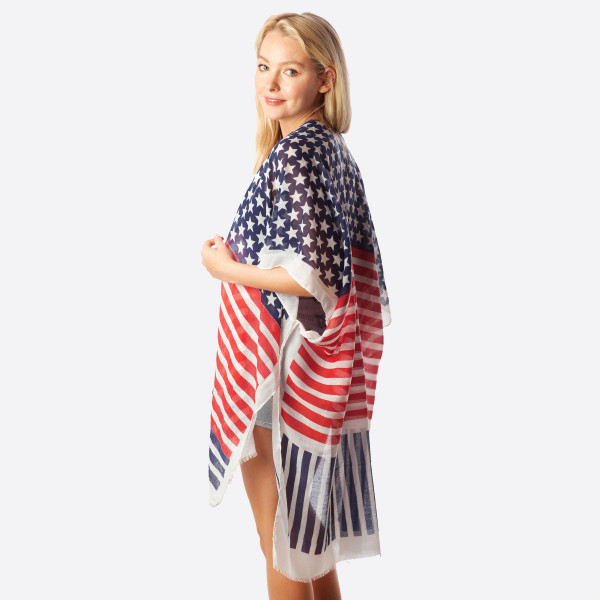 """Women' lightweight stars and stripes kimono.  - One size fits most 0-14 - Approximately 37"""" L - 30% Cotton, 70% Polyester"""