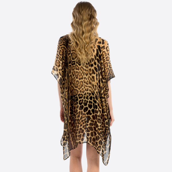 "Women's Lightweight Sheer Leopard Print Kimono.   - One size fits most 0-14 - Approximately 35"" in Length - 100% Polyester"