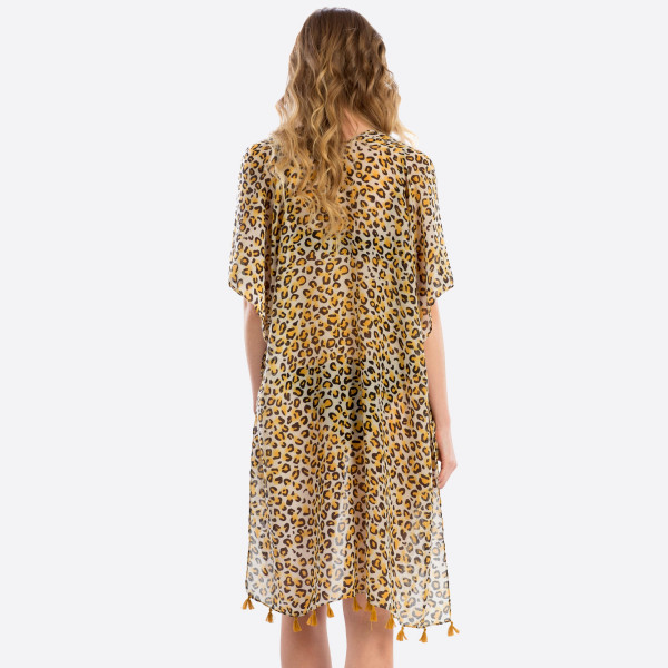 "Women's lightweight sheer leopard print tassel kimono.  - One size fits most 0-14 - Approximately 37"" L  - 100% Polyester"