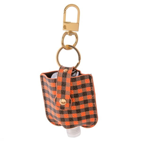 """Keep Your Self Protected While You're Out and About with This Cute Faux Leather Buffalo Check Hand Sanitizer Holder.  - Clip to your purse, bag, or diaper bag - Key ring to hold your keys - Fits up to 1fl.oz Sanitizer Bottle - Approximately 3"""" T x 2.5"""" W  ***Hand Sanitizer NOT INCLUDED. (Comes with empty Bottle)"""