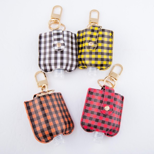 "Keep Your Self Protected While You're Out and About with This Cute Faux Leather Buffalo Check Hand Sanitizer Holder.  - Clip to your purse, bag, or diaper bag - Key ring to hold your keys - Fits up to 1fl.oz Sanitizer Bottle - Approximately 3"" T x 2.5"" W  ***Hand Sanitizer NOT INCLUDED. (Comes with empty Bottle)"